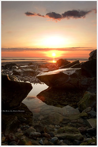 """Up With The Dawn"" Sunrise over Ogunquit; Tidal pools reflect the sun's rays along Maine's rocky coastal shore."