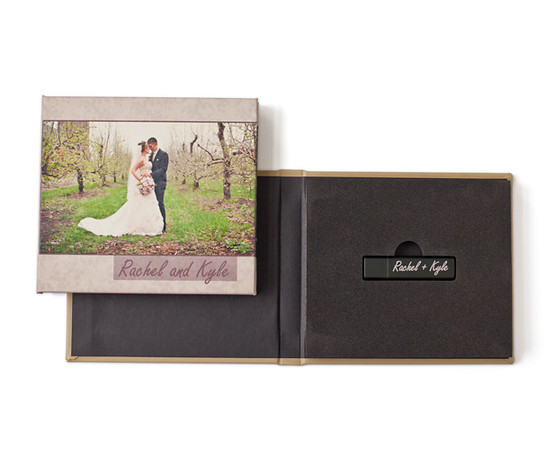 Instead of the DVD, for no additional charge, you can choose to have all of your wedding photos put on a USB drive that is then enclosed in a customized case such as the one above.