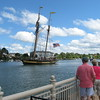 Richard Payerchin - The Morning Journal <br> Spectators at Black River Landing watch the Pride of Baltimore II turn in the river upon the tall ship's arrival in Lorain on Sept. 2, 2016. The vessel will dock in Lorain for Labor Day weekend. Public tours will be 10 a.m. to 2 p.m., Sept. 3, 4 and 5, at a cost of $5 per person. Children age 5 and younger will be admitted free. Day sails will be 3-5 p.m., Sept. 3, 4 and 5, for $65 for people 13 and older, or $35 for children 12 and younger. Advance ticket sales will be available through www.pride2.org and on the day of the cruises.