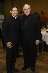 Bishop Michael Mulvey (right) and the banquet keynote speaker Fr. Brice Higginbotham (left) pose for a picture.
