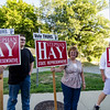 Supporters of current State Representative Stephan Hay hold signs outside of Fitchburg State University on Monday evening ahead of the debate against Kimatra Maxwell. SENTINEL & ENTERPRISE / Ashley Green