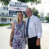 Stephanie Marchand stops by to greet father and State Representative candidate Rick Marchand as he campaigns outside Leominster City Hall during the primary elections on Thursday. SENTINEL & ENTERPRISE / Ashley Green
