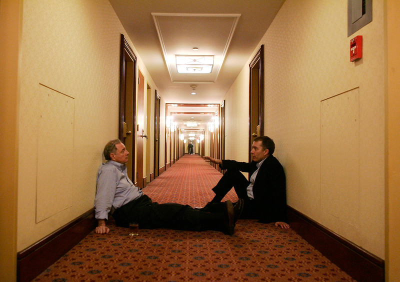 Prime Minister Paul Martin speaks with Party president Mike Eizinga in the hallway of Queen Elizabeth Hotel in Montreal, Quebec after losing the election.