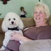 Fitchburg resident Lorelei McClure talks about her Bichon Frise Prince Charming who can detect seizures before they happen. SENTINEL & ENTERPRISE / Ashley Green