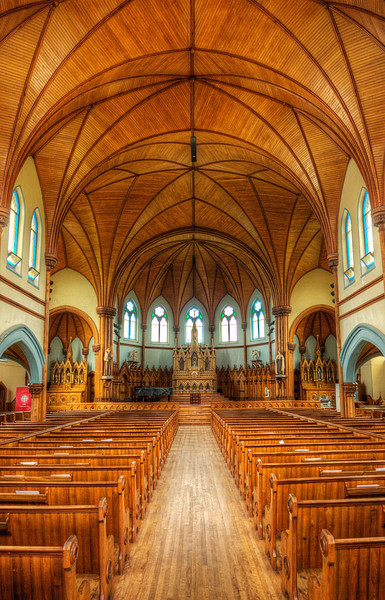 This is St Mary's Church in Indian River, Prince Edward Island. It was built in 1902 almost entirely of wood and is a pretty impressive piece of architecture when you consider that intricate rib-vaulted ceiling. It's huge. They don't do Church at St Mary's anymore. Instead it's a performance venue for all kinds of wonderful musical talent. It's also home to the Indian River Festival. — Shot 20, August, 2013 in Prince Edward Island.
