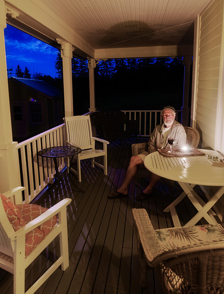 A glass of wine on the porch with Dad night before last. — in Stanley Bridge, Prince Edward Island.