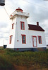 The North Rustico Light and its keeper continued to serve the harbor until 1960 when the light was automated.  In 1973 a modern light was erected near the lighthouse to assume its duties and the tower was declared surplus.  Local residents convinced the Coast Guard to return the light to the tower in 1976.