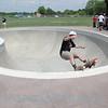 Black Shirt Skater Grinding in Bowl