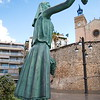 Statue of Woman Holding Grapes