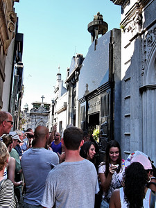 Crowds file pass Eva Peron's grave