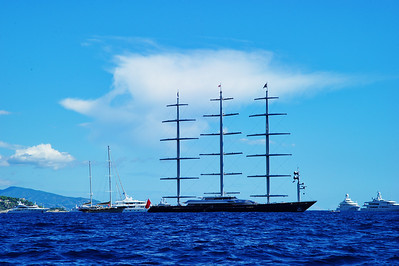 The large 3-mast sailing yacht is one of a kind.  The sails and rigging are all automatic, computer controlled.
