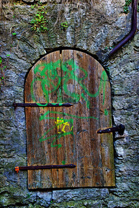 Grafitti on a medieval door?  now that's dumb!