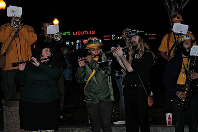 "The Marching Lumberjacks play ""The Imperial March"" during the Princess Leia Tribute at the Arcata Plaza.  (Natalya Estrada - The Times-Standard)"