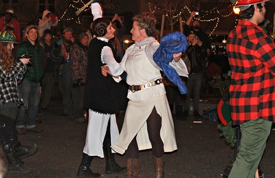 "Leia dances to Leia during the Marching Lumberjack's rendition of ""Princess Leia's Theme"" on Friday at the Arcata Plaza.  (Natalya Estrada - The Times-Standard)"