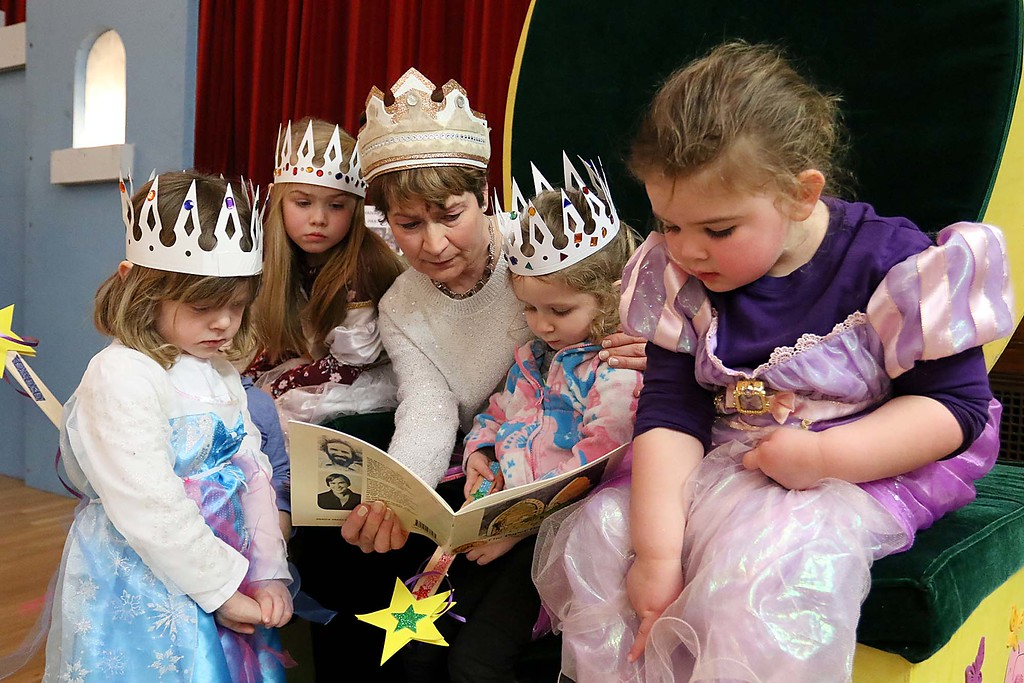 ". Thursday was ""Princess Day\"" at Leominster City Hall. Debbie Richards reads a book about dragons to some the princesses at the event. SENTINEL & ENTERPRISE/JOHN LOVE"