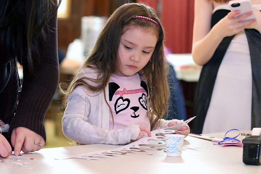 ". Thursday was ""Princess Day\"" at Leominster City Hall. Isabella Montrey, 5, of Leominster decorates a paper crown during the event. SENTINEL & ENTERPRISE/JOHN LOVE"