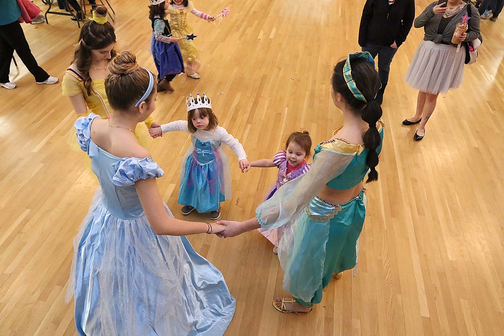 ". Thursday was ""Princess Day\"" at Leominster City Hall. Three of the princesses dance with Anna Logiodice, 3, of Leominster and Cadence Aquafresca, 3, during the event. SENTINEL & ENTERPRISE/JOHN LOVE"