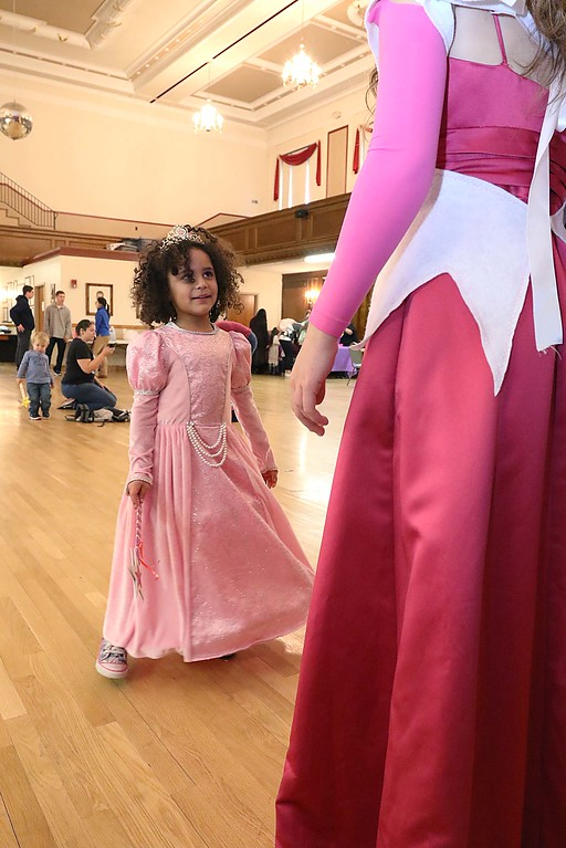 ". Thursday was ""Princess Day\"" at Leominster City Hall. Valeria Sosa, 6, dressed as Princess Tiana from the \""Princess and the Frog\"" enjoyed talking to Sarah Whittier, 13, who was playing Princess Aurora. SENTINEL & ENTERPRISE/JOHN LOVE"