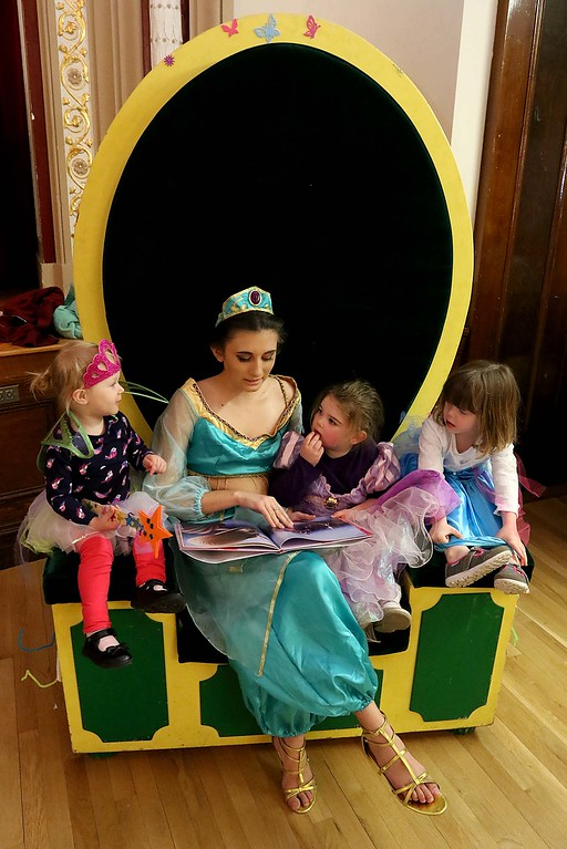 ". Thursday was ""Princess Day\"" at Leominster City Hall. Princess jasmine, aka Kaycee Deforte, 14, reads to, from left, Sylvia Radue, 2, Abigail Driscoll, 3, and Anna Logiodice, 3, at the event. SENTINEL & ENTERPRISE/JOHN LOVE"
