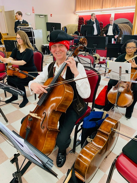 . Lowell Philharmonic Orchestra Secretary Charles Needles of Chelmsford plays the cello.