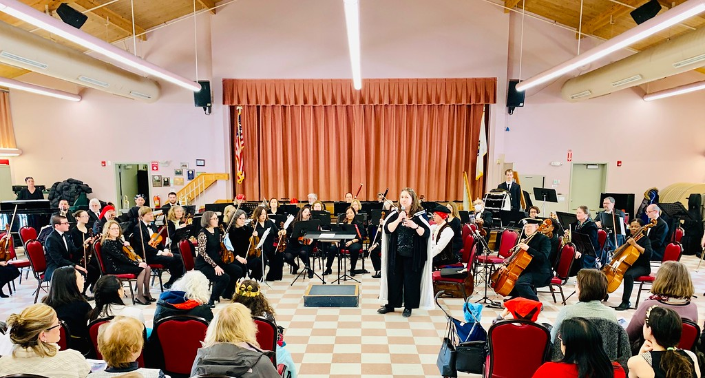 . The Lowell Philharmonic Orchestra with co-President Julia Harmon of Billerica