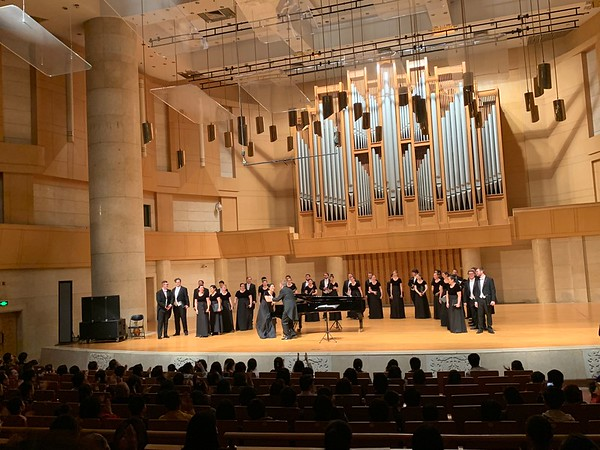Conductor Joe Miller congratulates choir member Yiran Zhao, who accompanied the ensemble performing the encore, a traditional Chinese  Youth Dance, which delighted the audience at the Forbidden City Concert Hall.
