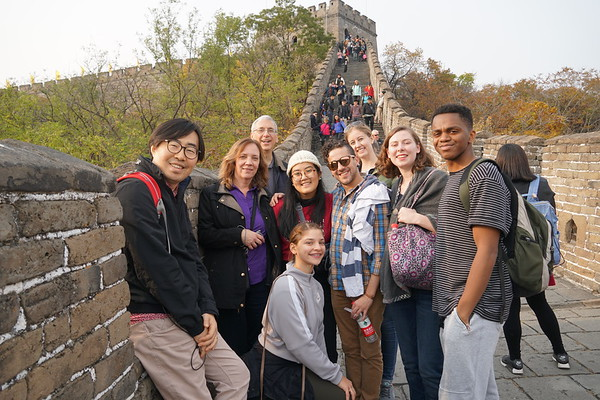 Dean Marshall Onofrio and his wife Susan with Westminster Choir members on the Great Wall of China.