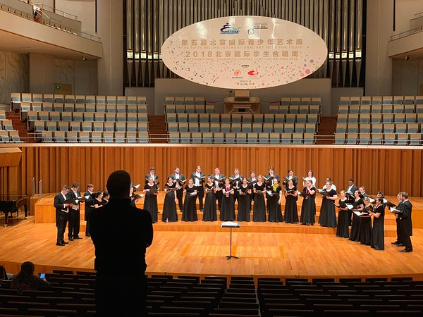 Soundcheck:  Joe Miller listens to the Westminster Choir preparing for its performance at the National Centre for the Performing Arts.