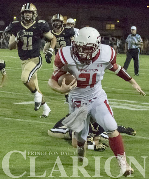 Princeton Community High School junior running back Joe Bichler rushes for a long gain during a game against Jasper Friday.