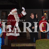 Rachel Graber Akpotu/Daily Clarion <br /> Santa waves for everyone to gather as Father Tony Ernst says a prayer before the lighting of the town Christmas tree in front of the Old Gym in Haubstadt Sunday evening.