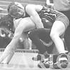 Princeton Community High School 113-pound wrestler Kyler McKinney breaks down junior Hunter Meyerholtz during a dual Thursday inside Tiger Arena.
