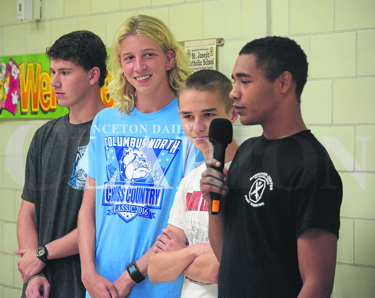 Members of the Princeton Community High School Cross Country team stopped by St. Joseph School Monday afternoon as part of Red Ribbon Week to talk to students about living a healthy, drug-free lifestyle. From left, Chandler Weeks, Justin Niederhaus, Drew Willis and Kahlil Wilkerson.
