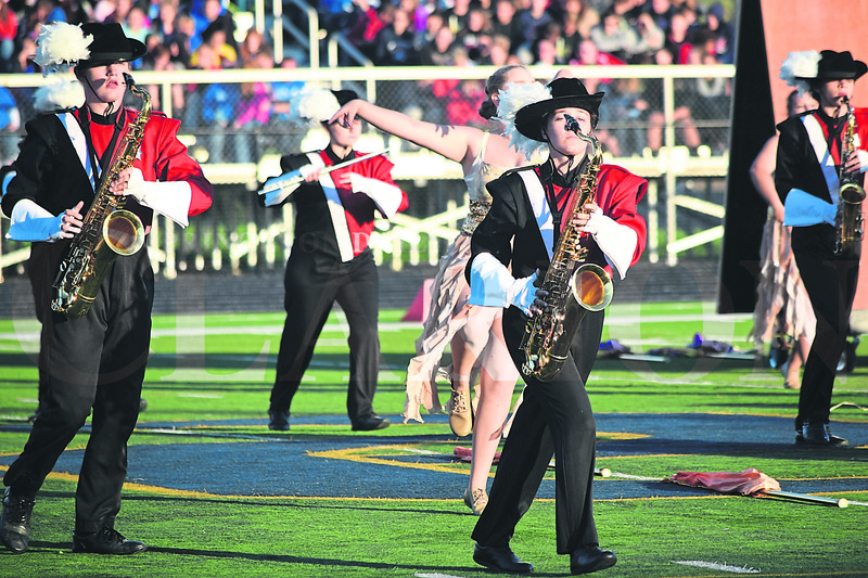 Daily Clarion/John Roark<br /> PCHS Marching Tigers saxophone players Kohyn Wethington (left) and Carley Wilder (middle) stay in formation during Saturday evening's Indiana State Scholastic Music Association Open Class C Semi-State Marching Band competiton at Indianpolis Decatur Central High School.