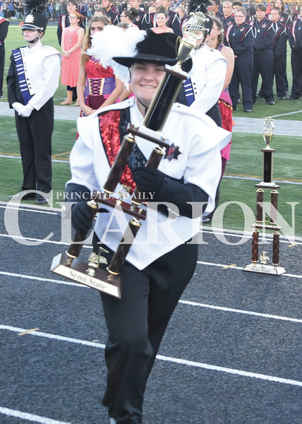 Daily Clarion/John Roark<br /> Tatum Hawkins, senior PCHS Marching Tigers Drum Major, is all smiles after being handed a Semi-State trophy following Saturday evening's Indiana State Scholastic Music Association Open Class C Semi-State Marching Band competiton at Indianapolis Decatur Central High School.