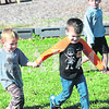 From left, Ryder Brengman, and Paxton Turner hold hands during a Red Ribbon Run Monday at St. Joseph School in Princeton. Students will participate in Red Ribbon activities the rest of the week as part of an anti-drug campaign.