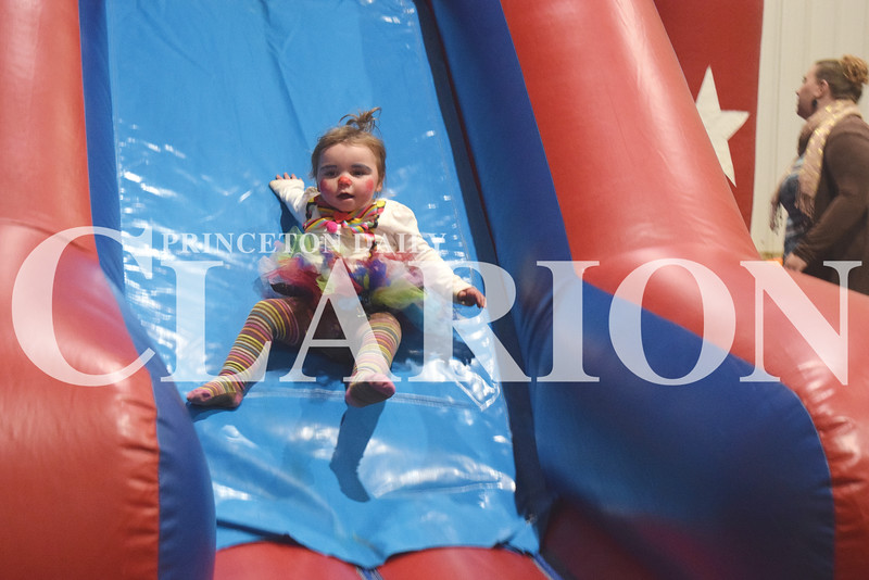 Leeah Belcher, 1, slides down the bouncy slide Thursday night at the Gibson County Fairgrounds Pavilion in Princeton. The event also featured small goody bags, games, hay rides for kids.