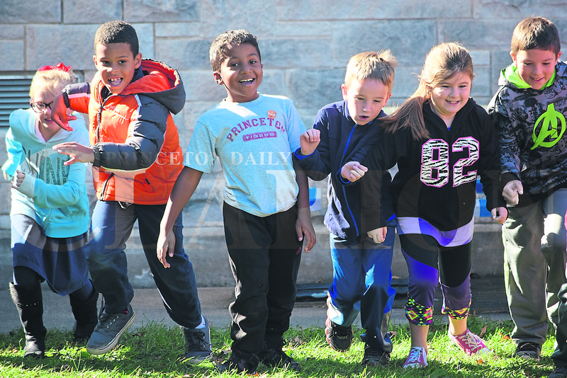 """St. Joseph Catholic School kicked off Red Ribbon Week Monday with a """"run away from drugs"""" themed jog around the playground. Students will be participating in activities all week that promote living a drug-free lifestyle."""