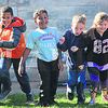 "St. Joseph Catholic School kicked off Red Ribbon Week Monday with a ""run away from drugs"" themed jog around the playground. Students will be participating in activities all week that promote living a drug-free lifestyle."