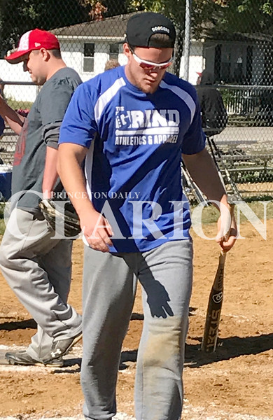 Daily Clarion/Andrea Howe<br /> Colton Wilder carries a bat left at home plate after he scores in Saturday's benefit softball tourney at Southside Park in Princeton. Proceeds from the event benefit the HOPE organization's efforts to supply equipment and fees for youths to participate in athletic programs.