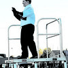 Daily Clarion/John Roark<br /> Tatum Hawkins, senior PCHS Marching Tigers Drum Major, directs her band during Saturday evening's Indiana State Scholastic Music Association Open Class C Semi-State competiton.