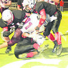 Daily Clarion/John RoarkPCHS linebacker Kane Madison (ground), Jaylan Hyneman (left) and Maleek Hardiman (right) denied Mount Vernon quarterback Cam Maier near the goal line, ending the first half of the Tigers' eventual 56-40 Senior Night win Friday.