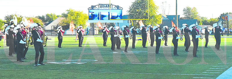 Daily Clarion/John Roark<br /> Princeton High School's Marching Tigers take the field during Saturday evening's Indiana State Scholastic Music Association Open Class C Semi-State Marching Band competiton at Indianapolis Decatur Central High School. PCHS just missed making the final field of 10 that advances to next week's state finals at Indianapolis' Lucas Oil Stadium.