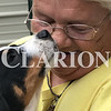 Daily Clarion/Andrea Howe  <br /> Gibson County Animal Servicess Director Foley gets a puppy kiss from one of the shelter animals.