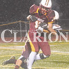 Daily Clarion/Andrea Howe<br /> Pike Central defensive back Hayden Cloe tries to take down Titan quarterback Isaac Sellers in the first quarter of Friday's 69-7 homecoming win for the Titans.