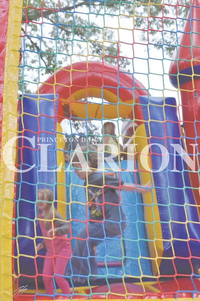 Daily Clarion/Andrea Howe<br /> Youngsters hop around in an inflatable fun house at Lyles Station Saturday afternoon during the New Beginnings Celebration.