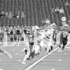 Titan Isaac Sellers rushes at Lucas Oil Stadium against Henderson County.