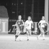 Katie Scott (#14) dribbles around a pair of Trojan defenders in a 6-0 sectional victory on Tuesday night. Scott tallied three goals in the win.