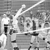 Brooke James (left) blocks a kill by Gibson Southern High School's Shealyn Riggs on Sept. 29.