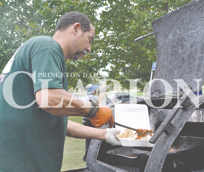 Daily Clarion/Andrea Howe<br /> Rodney Morris serves up a Drifters Barbecue pork sandwich at the Lyles Station New Beginnings Celebration Saturday afternoon. The celebration featured barbecue dinners, sandwiches and ribs from Drifters and Tim's Awesome Barbecue.