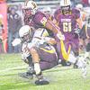 Titan defensive lineman Devon Montgomery takes down PIke Central's Dylan Brown.